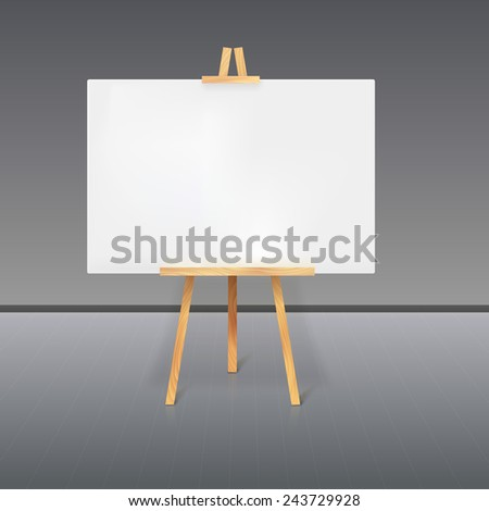Wooden tripod with a white sheet of paper standing in the room