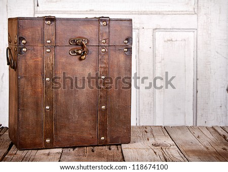Wooden trunk or chest on an antique wooden backgrounds - stock photo