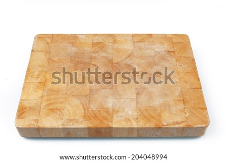 Wooden used cutting board on white background.