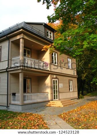Wooden villa in autumn park in Druskininkai, Lithuania - stock photo
