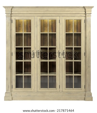Wooden vintage cupboard with glass doors - stock photo