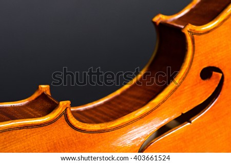 wooden violin part on black background, macro - stock photo