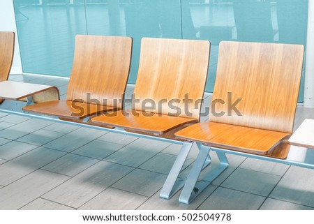 wooden waiting chair in airport