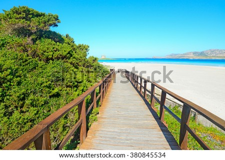 wooden walk path to the beach in Sardinia, Italy - stock photo