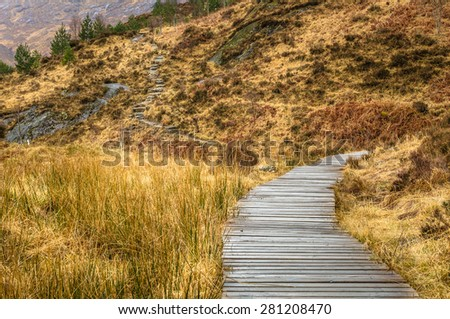 Wooden Walkway along a Mountain Path in Scotland - stock photo