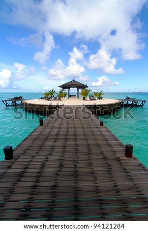 Wooden walkway at Kapalai island in the middle of the ocean. - stock photo