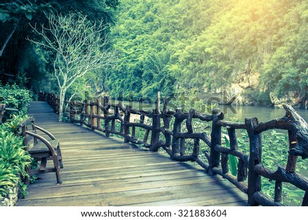 Wooden walkway beside the river Kwai in Thailand.