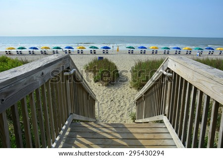 Wooden walkway / boardwalk to beach - stock photo