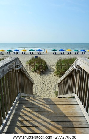 Wooden walkway / boardwalk to beach. Perfect for cover art. - stock photo
