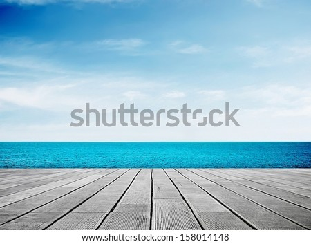Wooden walkway on sunny day - stock photo