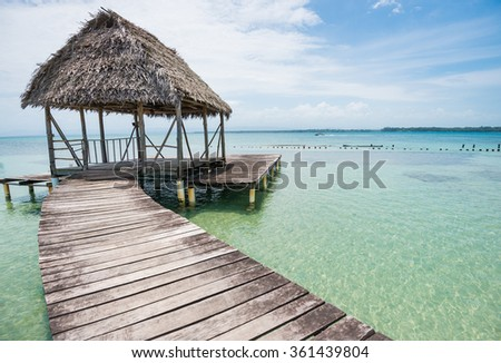 Wooden walkway with old hovel on the sea on Bocas del Toro in Panama - stock photo