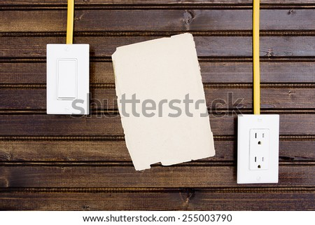 Wooden wall with adjustable sockets and switches. - stock photo