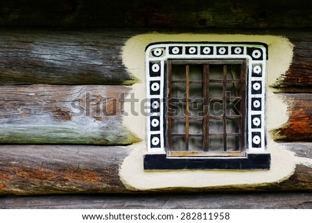 Wooden wall with old window - stock photo