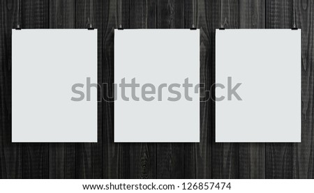wooden wall with three paper card - stock photo