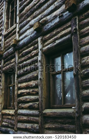 Wooden wall with windows of an old traditional Ukrainian house