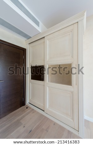 Wooden wardrobe with sliding doors