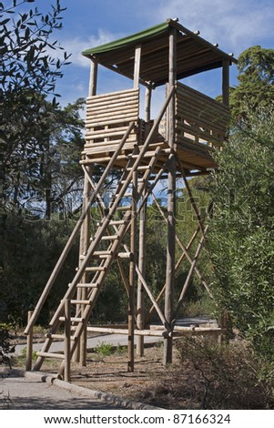 Wooden watch tower in the grove to prevent forest fires - stock photo