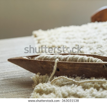 Wooden weaving loom tool for keeping the thread. - stock photo