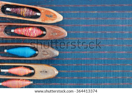 wooden weaving shuttle for homemade silk or textile production - stock photo