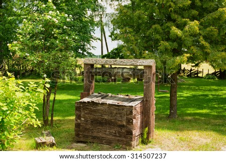 Wooden well. Wooden construction for water