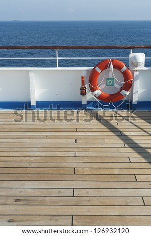Wooden wharf,buoy and blue sea - stock photo