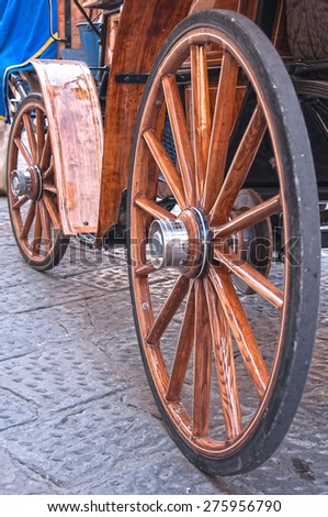 Wooden wheels on an old carriage.