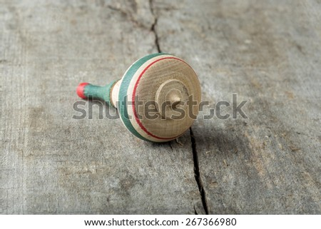 Wooden whirligig over wooden old background - stock photo