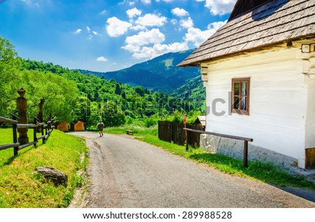Wooden white hut in beautiful Vlkolinec traditional village in Slovakia, Eastern Europe  - stock photo