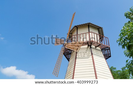 Wooden Windmill on blue sky