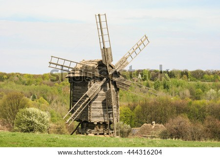 wooden windmill standing in the village