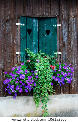 wooden window decorated with flowers - stock photo