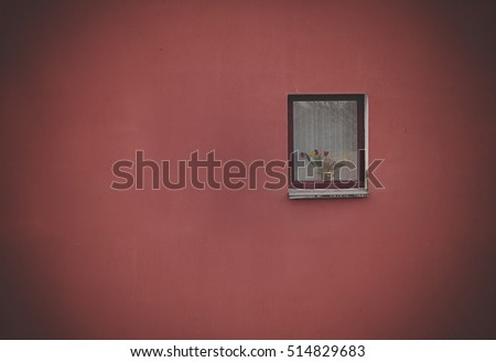 Wooden window on a red wall