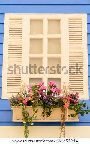 wooden window with wooden wall and flowerpot - stock photo