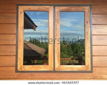 wooden windows frame with blue sky background