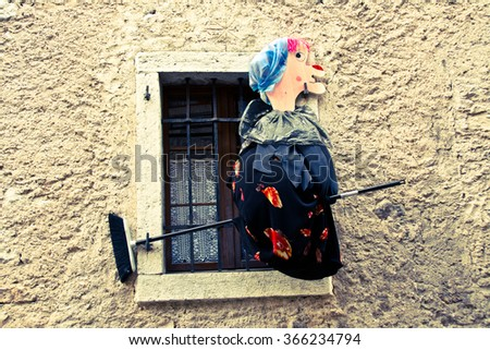 wooden witch doll , photographed in the Dolomite's , Italy  - stock photo