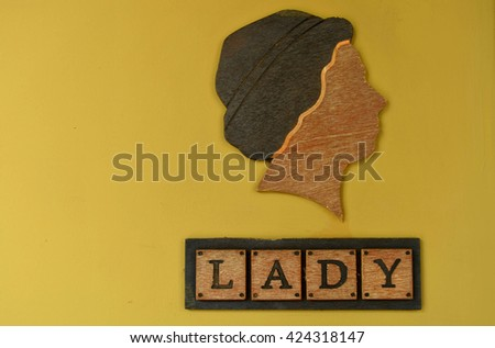 Wooden woman restroom sign - yellow tone