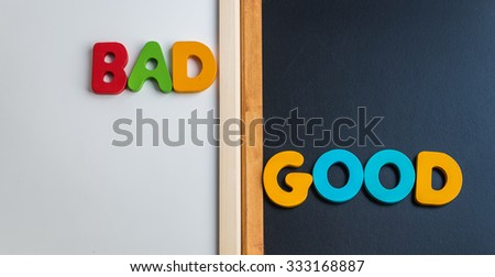 Wooden word BAD and GOOD on black board and white board