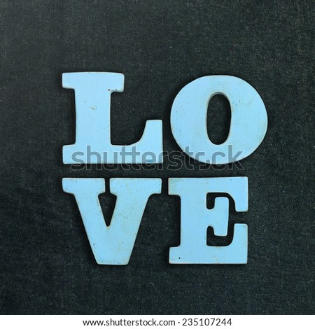 wooden word love on the chalkboard - stock photo