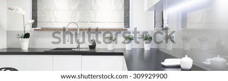 Wooden worktop in beauty kitchen interior - panorama - stock photo