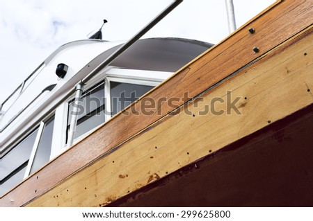 wooden yacht in small shipyard for repair and restoration its hull