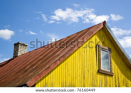 Wooden yellow house and blue sky