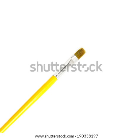 Wooden yellow Paint Brush isolated over white