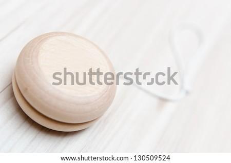 Wooden yo-yo toy - stock photo