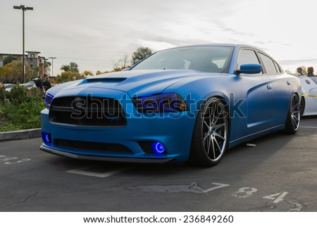 Woodland Hills, CA - December 7, 2014:  CustomDodge Charger RT on display at the 11th Annual Motor4toys Charity Car Show and Toy Drive