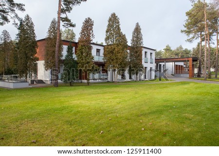 Woodland hotel - Hotel building in a forest - stock photo