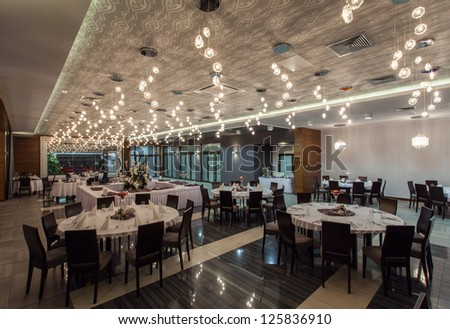Woodland hotel - Spacious restaurant room with lights - stock photo