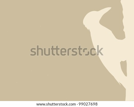 woodpecker silhouette on brown background - stock photo