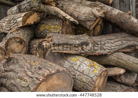 Woodpile of chopped lumber. Pile of wood logs. Stacked firewood timber. - stock photo