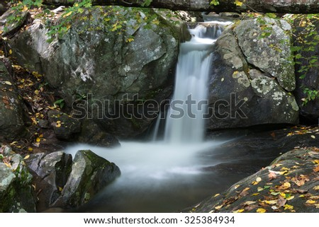Woodward Falls is a beautiful spot located near the Blue Ridge Parkway near Asheville, North Carolina in the mountains and flows through the small town of Montreat. - stock photo
