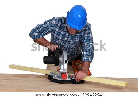 Woodworker using miter saw - stock photo
